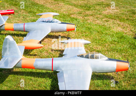 Model planes on a green field in the summer waiting for take-off - Stock Image