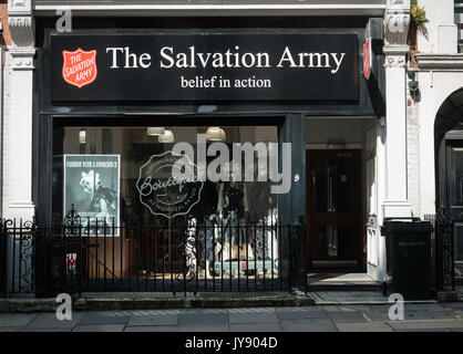The Salvation Army Boutique charity shop in Princes St, Mayfair, London UK. Frequently hosts collections created by students at Central St Martins. - Stock Image