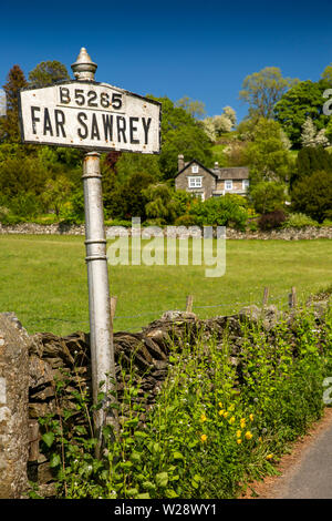 UK, Cumbria, Hawkshead, Far Sawrey, old village sign on B5285 road to Bowness Ferry - Stock Image