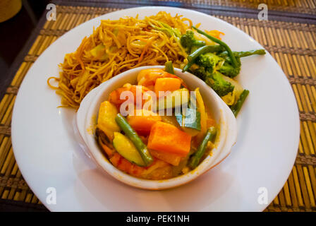 Asian style self service buffet meal, with noodle, broccoli and vegetable and prawn stew, Barbes, Paris, France - Stock Image