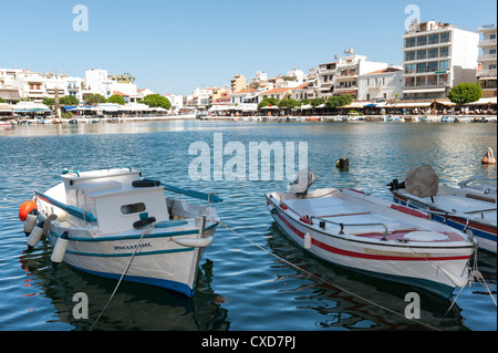 Traditionally painted wooden boats on the lake at Agios Nikolaos, Crete, Greece - Stock Image
