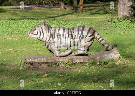 Wooden Tiger Carving, Royal Botanic Gardens, Kew, Richmond, Surrey, England, Britain, UK - Stock Image
