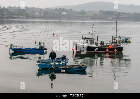 Schull, West Cork, Ireland. 1st Apr, 2019. A fisherman returns to Schull Harbour after setting his crab pots in the bay. The day will be mostly cloudy with some sunny spells with highs of 9 to 13° Celsius. Credit: Andy Gibson/Alamy Live News. - Stock Image