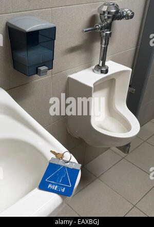 key for men's restroom left on sink - Stock Image