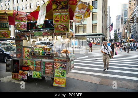 Food cart selling hot dogs and Pretzels on the streets of New York City - Stock Image