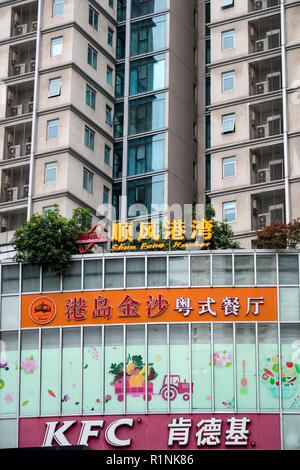 Residential tower block above a KFC restaurant in Shanghai, China - Stock Image