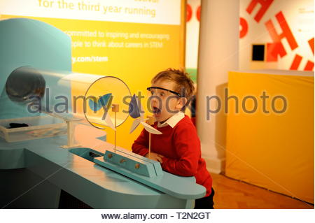 """Edinburgh, UK. 3rd April, 2019.  Edinburgh, UK. 3rd April, 2019.  Colin from Royal Mile Primary School trying out wind turbine exhibits at """"Energy Makers """" a new workshop at the City Art Centre (CAC) presented by the Festival's headline sponsors, EDF Energy. Credit: Roger Gaisford/Alamy Live News - Stock Image"""