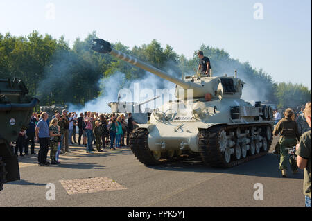 ENSCHEDE, THE NETHERLANDS - 01 SEPT, 2018: A tank from the second world war rolling during a military army show. - Stock Image