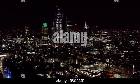 Aerial View of Urban City at Night. Modern High Rise Buildings and Office Towers in Business and Financial District. High Up Shot of London City UK - Stock Image