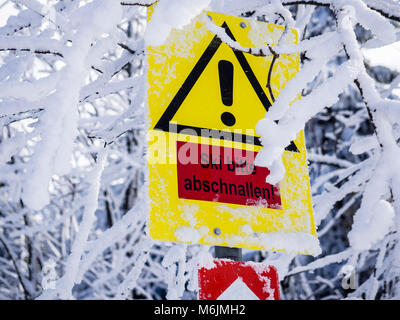 Warning sign on loipe, steep hill,  take off skis, Harz, Lower-Saxony, Germany - Stock Image