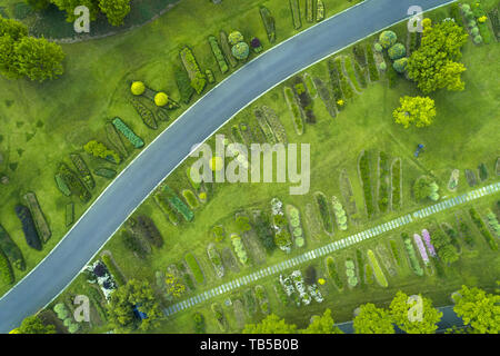 Aerial view of  park with a green lawn and paths - Stock Image