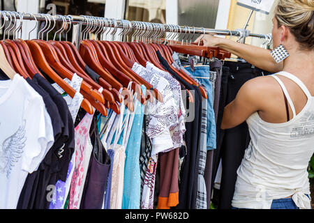 Fort Lauderdale Ft. Florida Las Olas Boulevard store clothes clothing rack hangers sale woman browsing business shop shopping fa - Stock Image