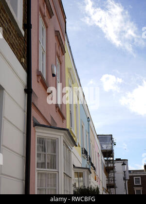 Colourful terraced houses in a street in Chelsea, London.UK - Stock Image