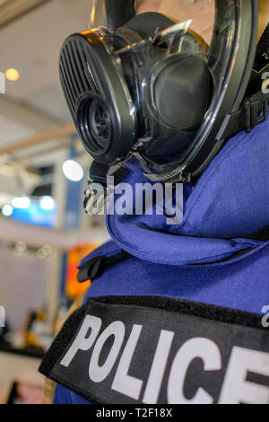 Mannequin in Police uniform and wearing safety mask - Stock Image