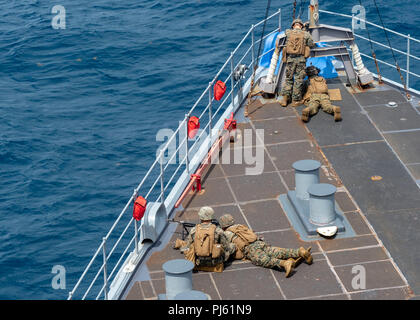 180902-N-AT530-0033 ATLANTIC OCEAN (Sep. 2, 2018) – Marines from the 22nd Marine Expeditionary Unit scan the horizon during a exercise on the amphibious dock landing ship USS Fort McHenry (LSD 43) during Carrier Strike Group FOUR (CSG 4) Amphibious Ready Group, Marine Expeditionary Unit exercise (ARGMEUEX). Kearsarge Amphibious Ready Group and 22nd Marine Expeditionary Unit are enhancing joint integration, lethality and collective capabilities of the Navy-Marine Corps team through joint planning and execution of challenging and realistic training scenarios. CSG-4 mentors, trains and assesses E - Stock Image