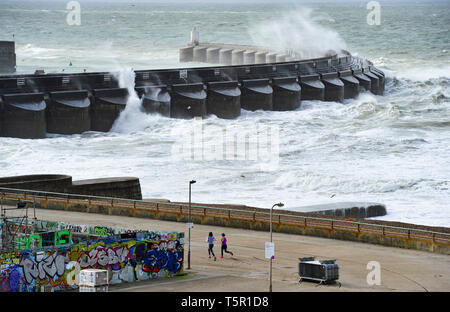 Brighton, UK. 27th Apr, 2019. Huge waves crash over Brighton Marina wall as Storm Hannah hits Britain this morning with strong winds forecast to affect parts of the country Credit: Simon Dack/Alamy Live News - Stock Image