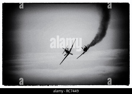 Second World War dogfight air warfare. A modern image processed to appear to show a gun camera photograph of World War Two air battle with plane smoke - Stock Image