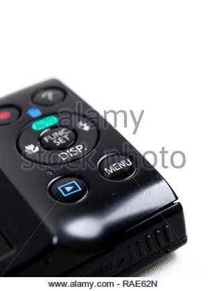 menu button on pocket camera body isolated white background - Stock Image