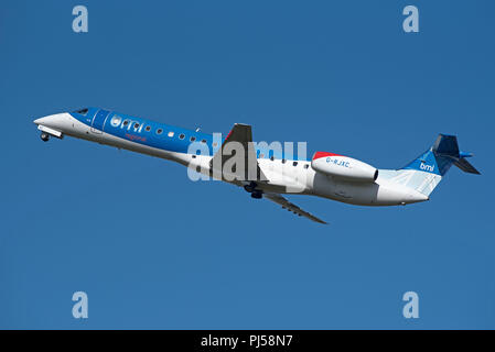 An Embraer ERJ-145 DEPARTING iNVERNESS airport on its scheduled flight to Dublin in Ireland. - Stock Image