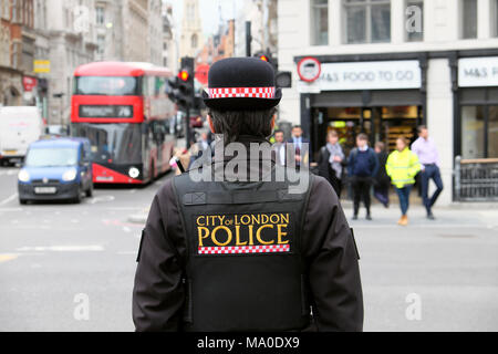 City of London Police logo on back of uniform jacket of policewoman (police woman) on the street in Farringdon area of Central London UK  KATHY DEWITT - Stock Image
