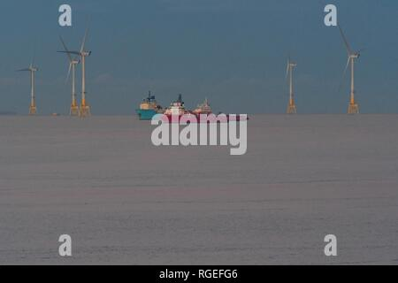 Aberdeen, Scotland, UK - 29 January 2019: uk weather - a perfectly calm North Sea off Aberdeen Harbour combined with the pale pink colours at dusk create  the illusion that the ships and offshore wind farm are in a field of snow. Credit: Kay Roxby/Alamy Live News - Stock Image