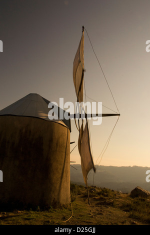 An old windmill still working on the top of the mountain. - Stock Image