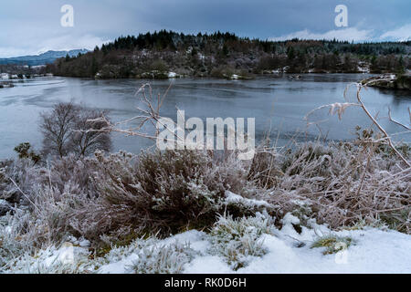 The partly frozen Llyn (Lake) Elsi in Betws-y-Coed, Snowdonia,Wales, UK - Stock Image