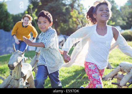 Children running in field - Stock Image