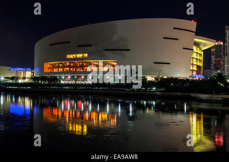 Night time view across water of windows on north side of the American Airlines Arena on Biscayne Blvd. in Miami, - Stock Image