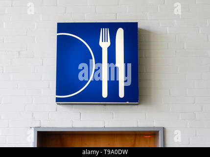 31.03.2019, Hannover, Lower Saxony, Germany - Knife and fork with plate symbol above a door at the Hannover Fair. 00X190331D041CAROEX.JPG [MODEL RELEA - Stock Image