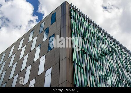 A modern city building in London against a cloudy sky - Stock Image