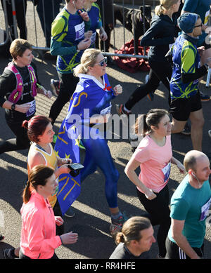 Brighton, UK. 24th Feb, 2019. Runners in the Grand Brighton Half Marathon head along the seafront on a beautiful sunny morning . Over 13000 runners were expected to take part in aid of the Sussex Beacon charity Credit: Simon Dack/Alamy Live News - Stock Image