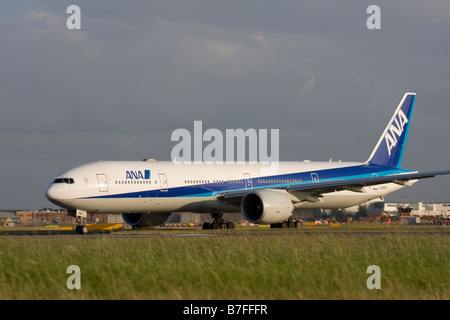 All Nippon Airways - ANA Boeing 777-381/ER taxiing for departure at London Heathrow airport. - Stock Image