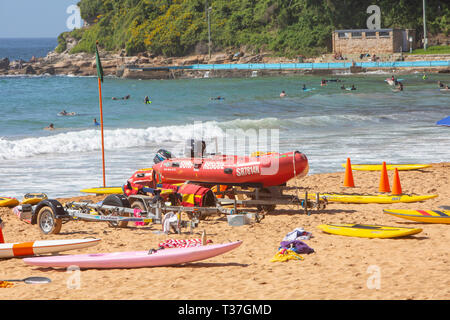 Surf rescue equipment and dinghy boat on Palm beach in Sydney,Australia - Stock Image