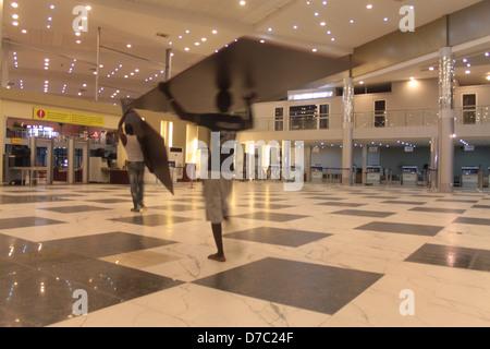 Workmen at the departure lounge of the Murtala Muhammed International Airport, Ikeja, Lagos, - Stock Image