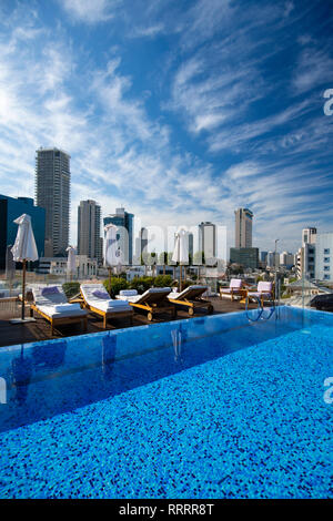 Tel Aviv's skyline from the rooftop swimming pool of The Norman, boutique hotel, Israel - Stock Image