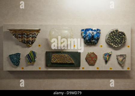 Various fragments of Roman broken glass and millefiori in Rolin Museum Autun France - Stock Image