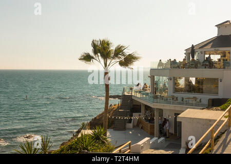 Beach bar, People sitting high level terrace overlooking the mediterranean sea, Benalmadena, Andalusia, Spain - Stock Image