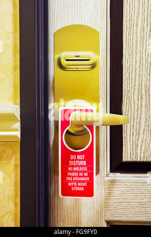 Do Not Disturb sign on a hotel room door - Stock Image