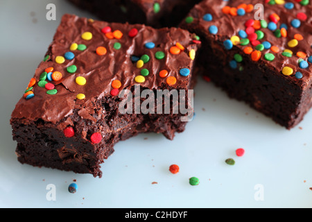 Close-up of chocolate brownies with multi-colored sprinkles - Stock Image