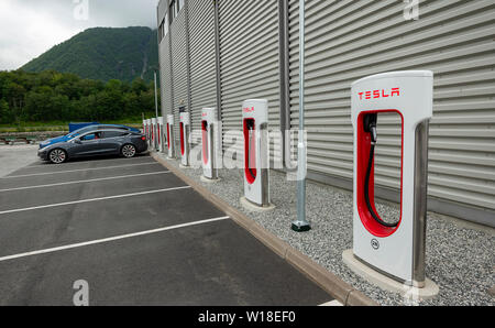 Tesla electric car charging station in Andalsnes, Norway - Stock Image