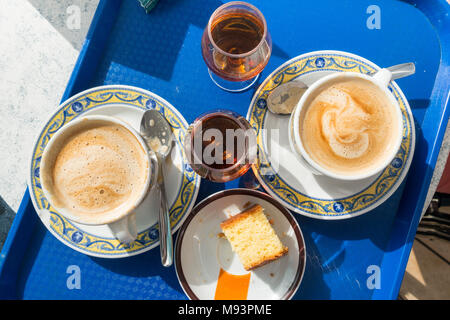 Traditional coffee, Brandy and cake for breakfast in Benidorm, Spain - Stock Image