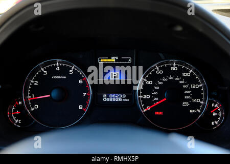 Electronic car dashboard for a 2014 Subaru Outback showing the speedometer, odometer, tachometer and gauges. - Stock Image