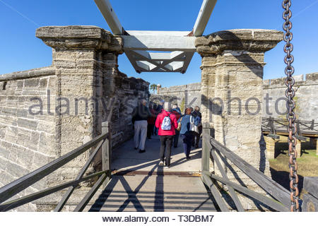 A tour group enters the ravelin, or outwork fortification, at the Castillo de San Marcos, a Spanish fortification at St. Augustine, Florida USA - Stock Image