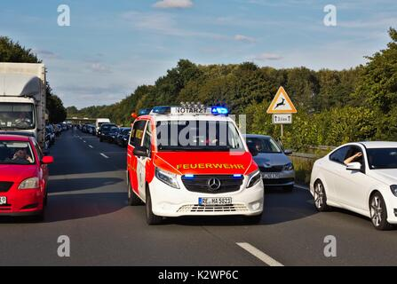 Cars on German motorway leaving a passage for emergency vehicles - Stock Image