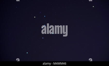 Orion Constellation in winter night sky including bright stars Betelgeuse (left arm), Bellatrix (right arm), Meissa - Stock Image