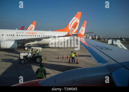 Congonhas airport operation, ground crew works at aircraft landing area managing taxiway signs ( airport guidance signs ) by providing direction and information to taxiing aircraft and airport vehicles, Sao Paulo, Brazil. - Stock Image