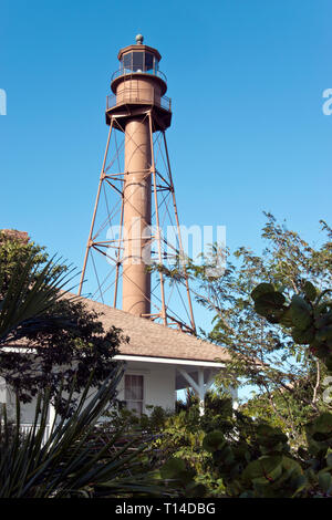 The 98-foot tall iron Sanibel Island lighthouse was first lighted in 1884, on Sanibel Island, a barrier island near Fort Myers, Florida. - Stock Image