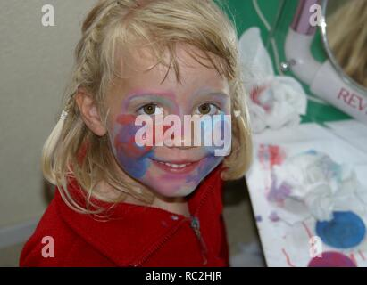 Naughty little girl painted face - Stock Image