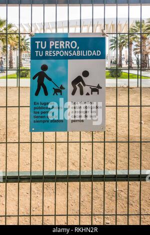 Dog poop scoop area, sign in spanish, Malaga port, Spain. - Stock Image